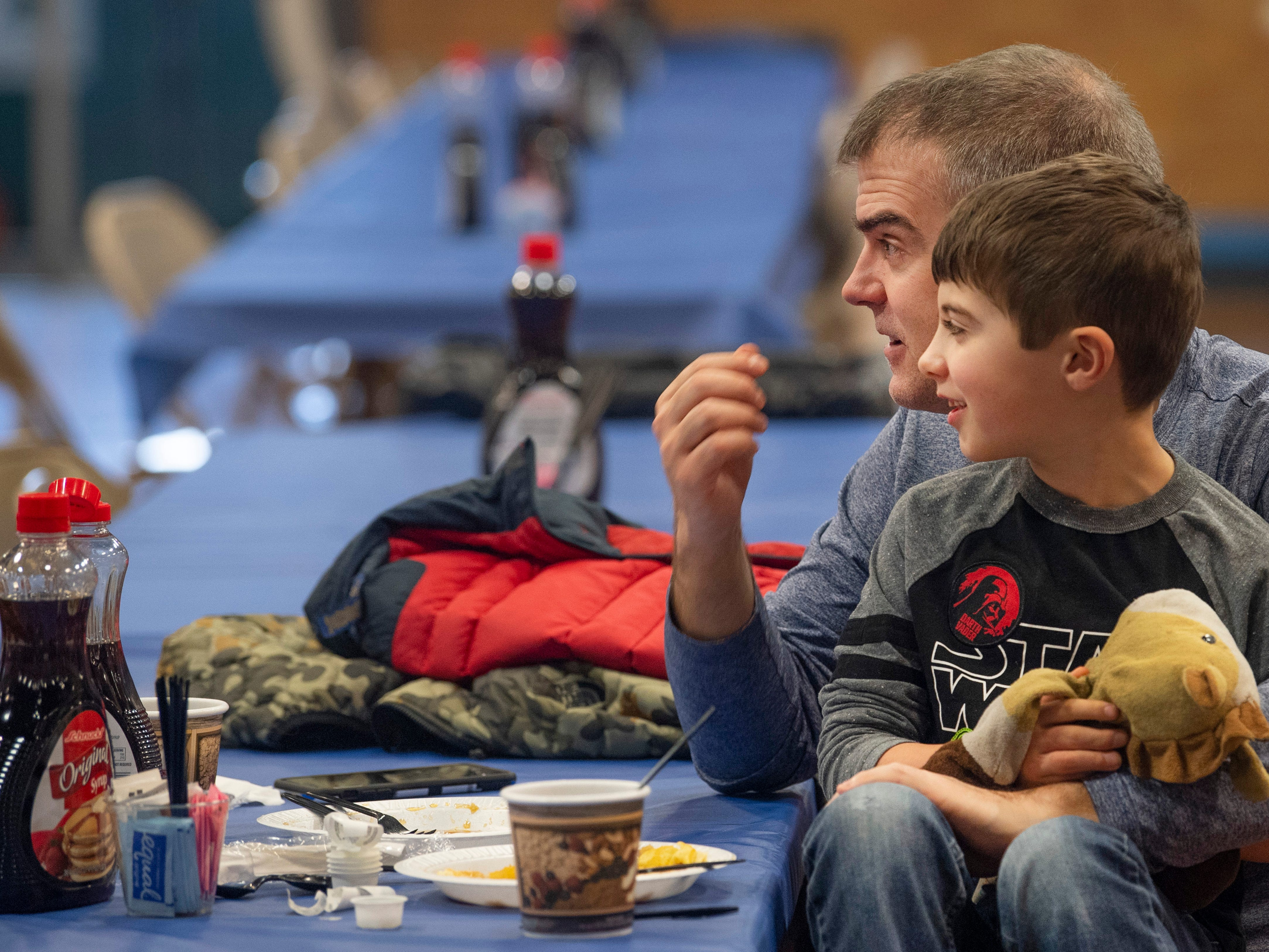 Troy Vaupel and his son, Ethan, 7, finish up their last batch of pancakes at the 31st Annual Pancake Days at the Downtown YMCA Friday morning. The pancakes, sausage, milk, coffee and orange juice will be served up again Saturday from 6 a.m. to 1 p.m. and Sunday from 8 a.m. to 1 p.m.