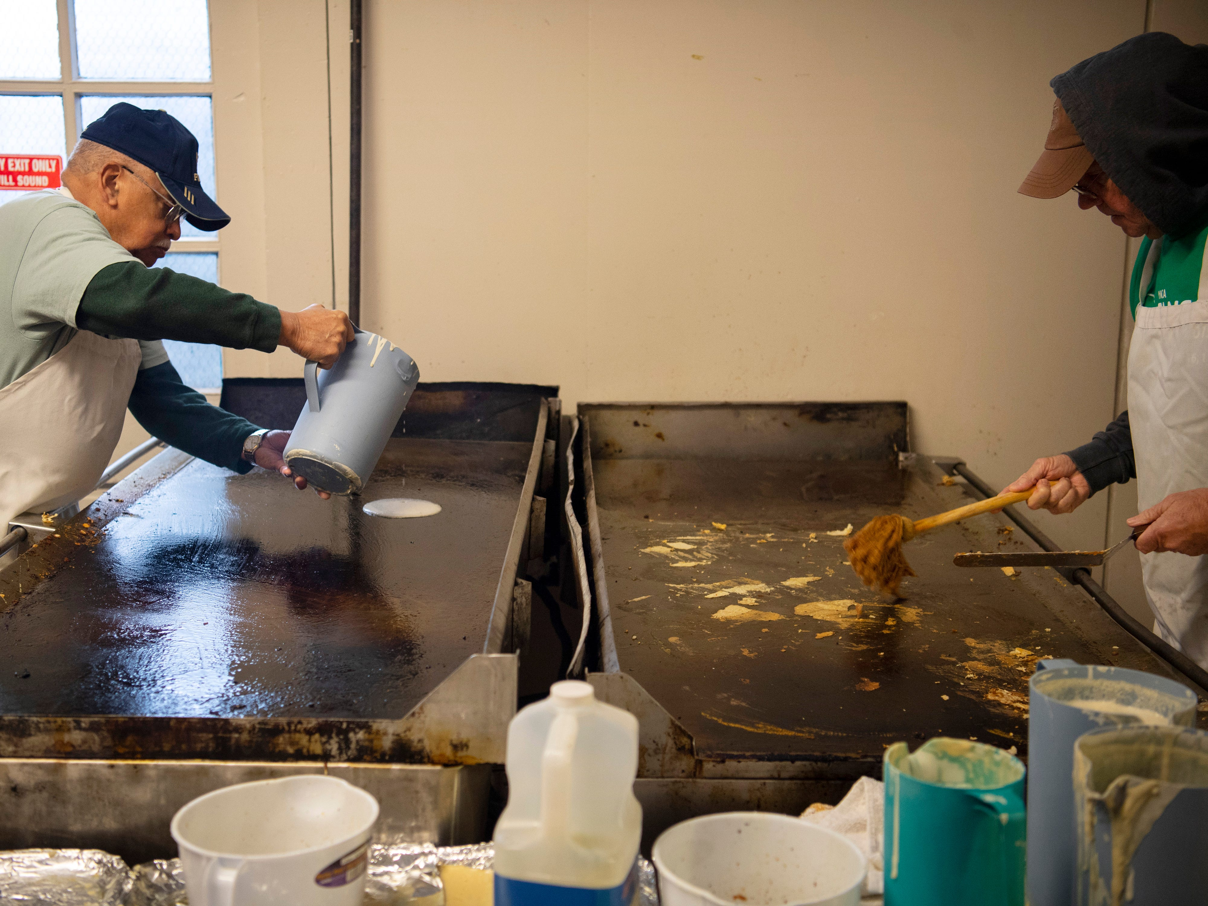 David Weir, left, and Burt King man the griddles at the 31st Annual Pancake Days at the Downtown YMCA Friday morning. The pancakes, sausage, milk, coffee and orange juice will be served up again Saturday from 6 a.m. to 1 p.m. and Sunday from 8 a.m. to 1 p.m.