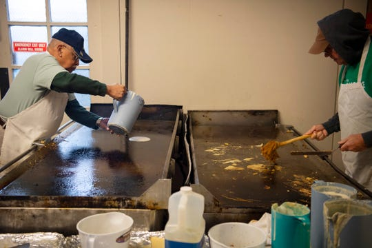 David Weir, left, and Burt King man the griddles at the 31st Annual Pancake Days at the Downtown YMCA during 2019's Pancake Days.