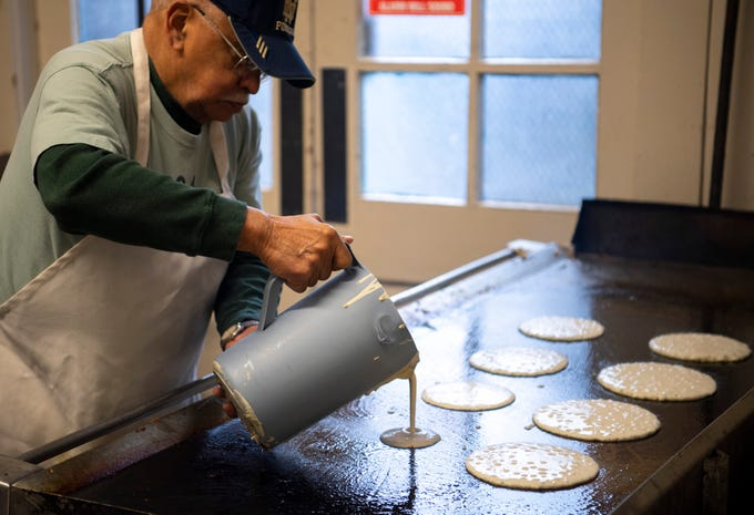 David Weir loads his griddle with pancake batter at the 31st Annual Pancake Days at the Downtown YMCA Friday morning. The pancakes, sausage, milk, coffee and orange juice will be served up again Saturday from 6 a.m. to 1 p.m. and Sunday from 8 a.m. to 1 p.m.