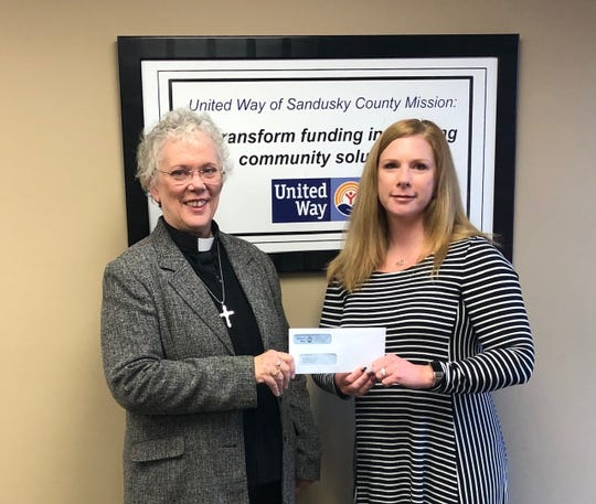 Grace Lutheran senior pastor Jody Rice, left, with United Way Executive Director Abby Slemmer.