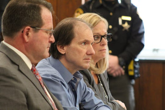 Daniel Myers, middle, flanked by attorneys Merle Dech, near, and Jane Roman, far, of Toledo, was sentenced to life in prison without parole Wednesday after he pleaded guilty to the murder of Heather Bogle.