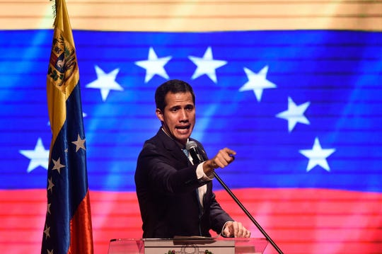 Venezuelan opposition leader and self declared acting president Juan Guaido speaks during meeting with workers and union leaders, in Caracas on February 14, 2019.