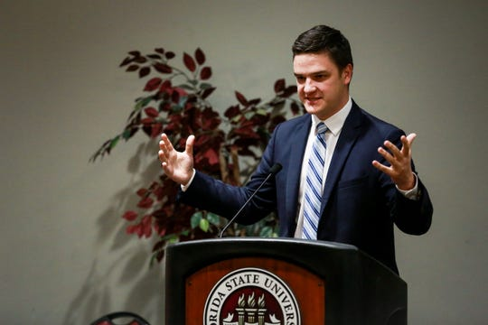Unite Presidential candidate, Carlton DiSalvo, giving his remarks during the SGA Executive debate on Thursday, Feb. 14..