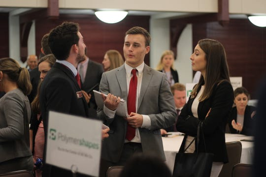 Students in the College of Business talk amongst their groups after the speed-selling competition.