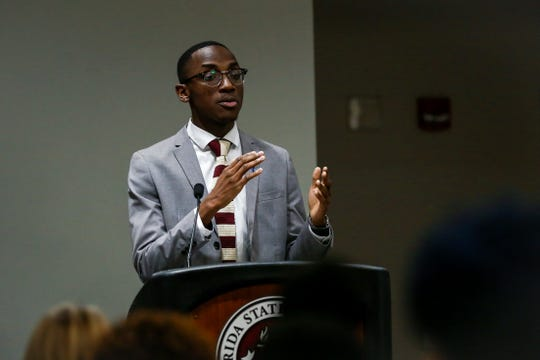 Amplify Treasurer Candidate, Caleb Dawkins, giving his remarks during the SGA Executive Debate on Thursday, Feb. 14.