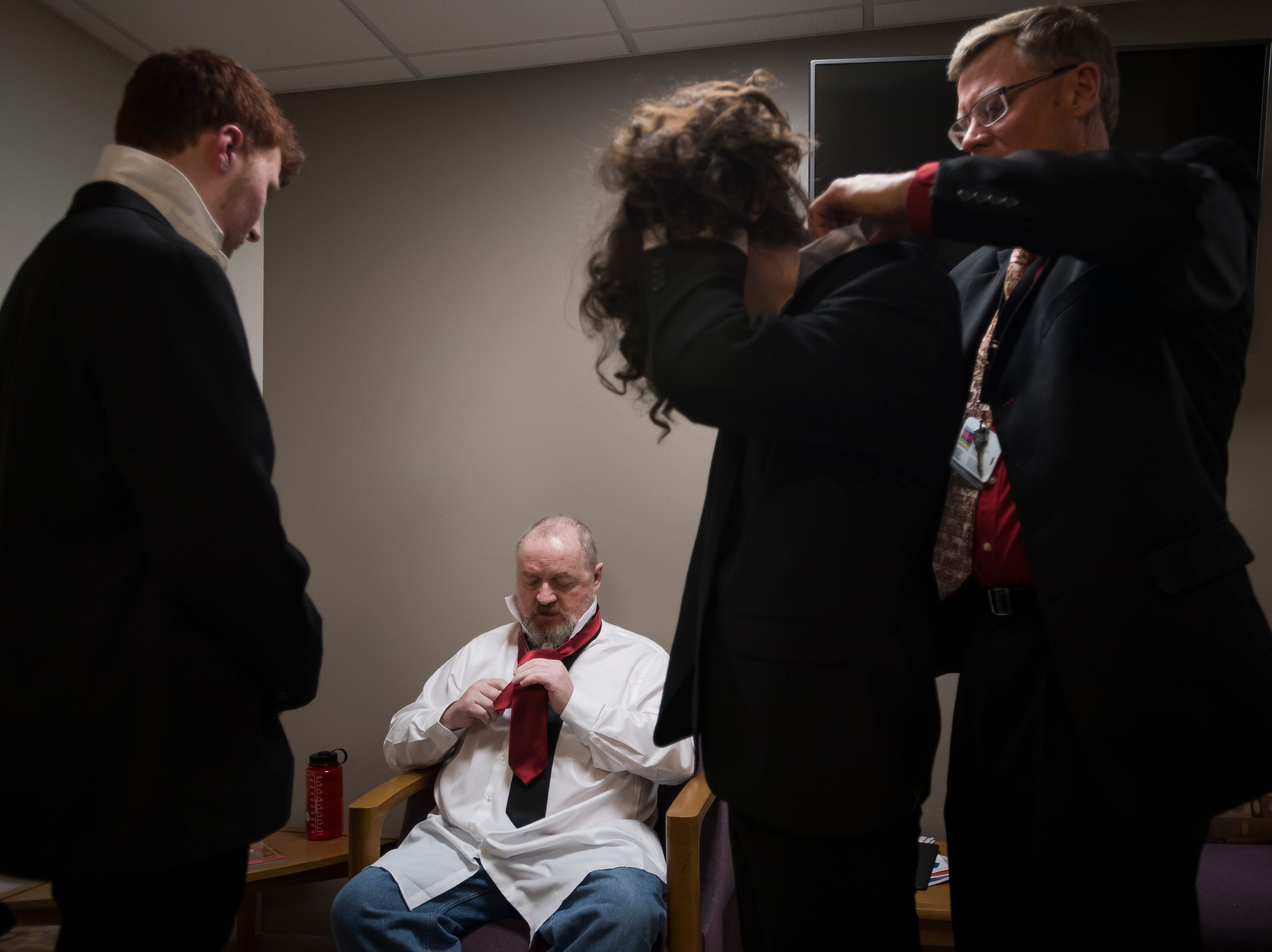 """From left, groom James """"Christian"""" Christian, father of the bride Paul Justice, brother of the bride Dean Justice, and chaplain Terry Skov get ready for a wedding on Thursday, Feb. 14, 2019, at UCHealth Poudre Valley Hospital in Fort Collins, Colo."""