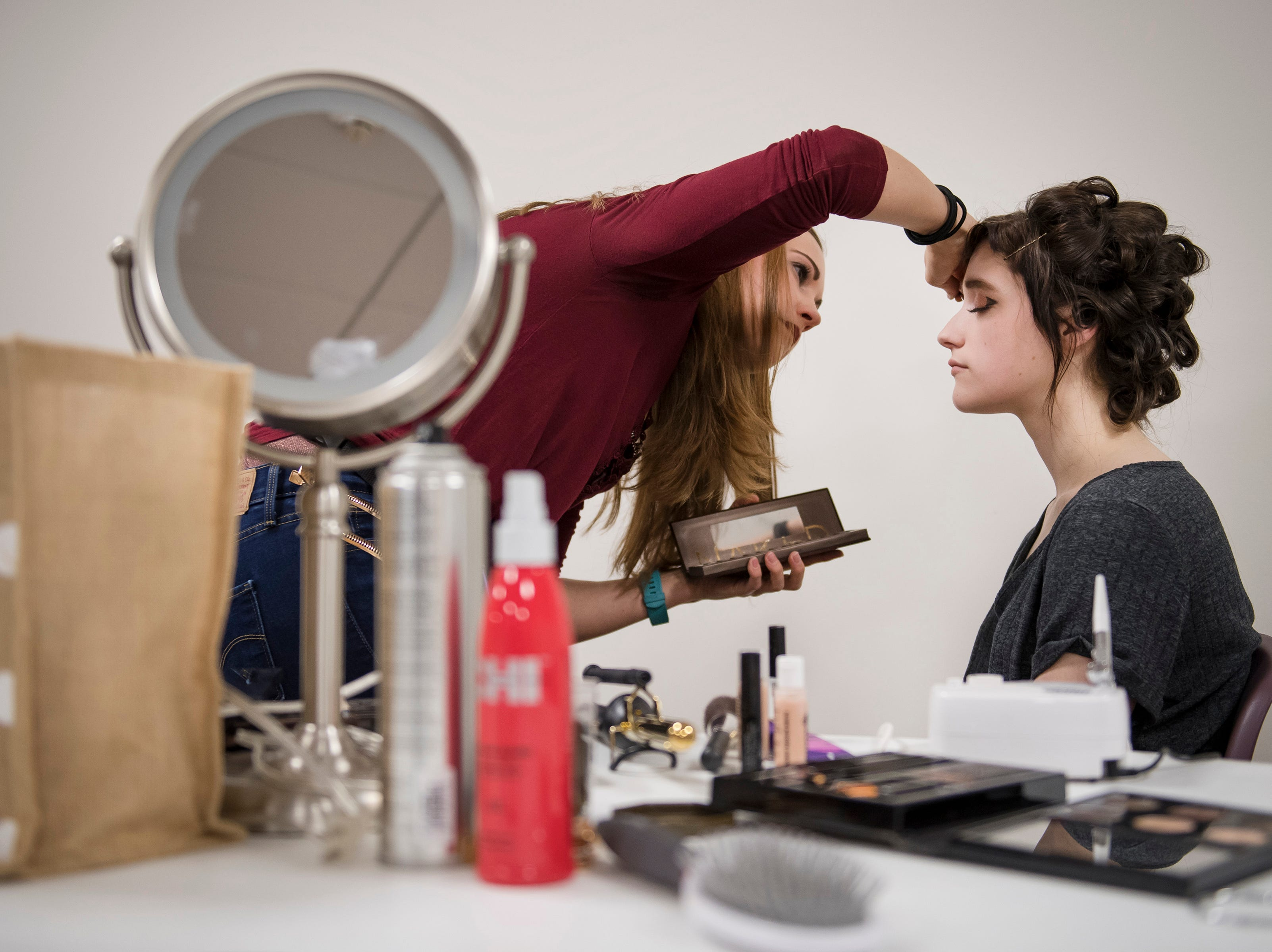 UCHealth patient care assistant Jessica Purkal does hair and makeup for the bride, Grace Justice before her wedding on Thursday, Feb. 14, 2019, at UCHealth Poudre Valley Hospital in Fort Collins, Colo.