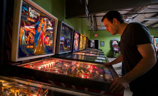 Local TV weatherman Eric Stone participates in a monthly league tournament at The Pinball Asylum in Fort Myers Thursday, February 14, 2019.