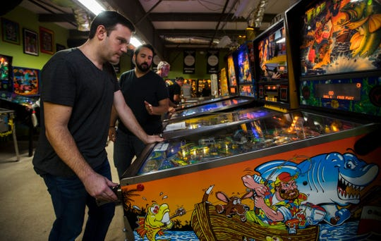 Local TV weatherman Eric Stone participates in a weekly league tournament at The Pinball Asylum in Fort Myers Thursday, February 14, 2019.