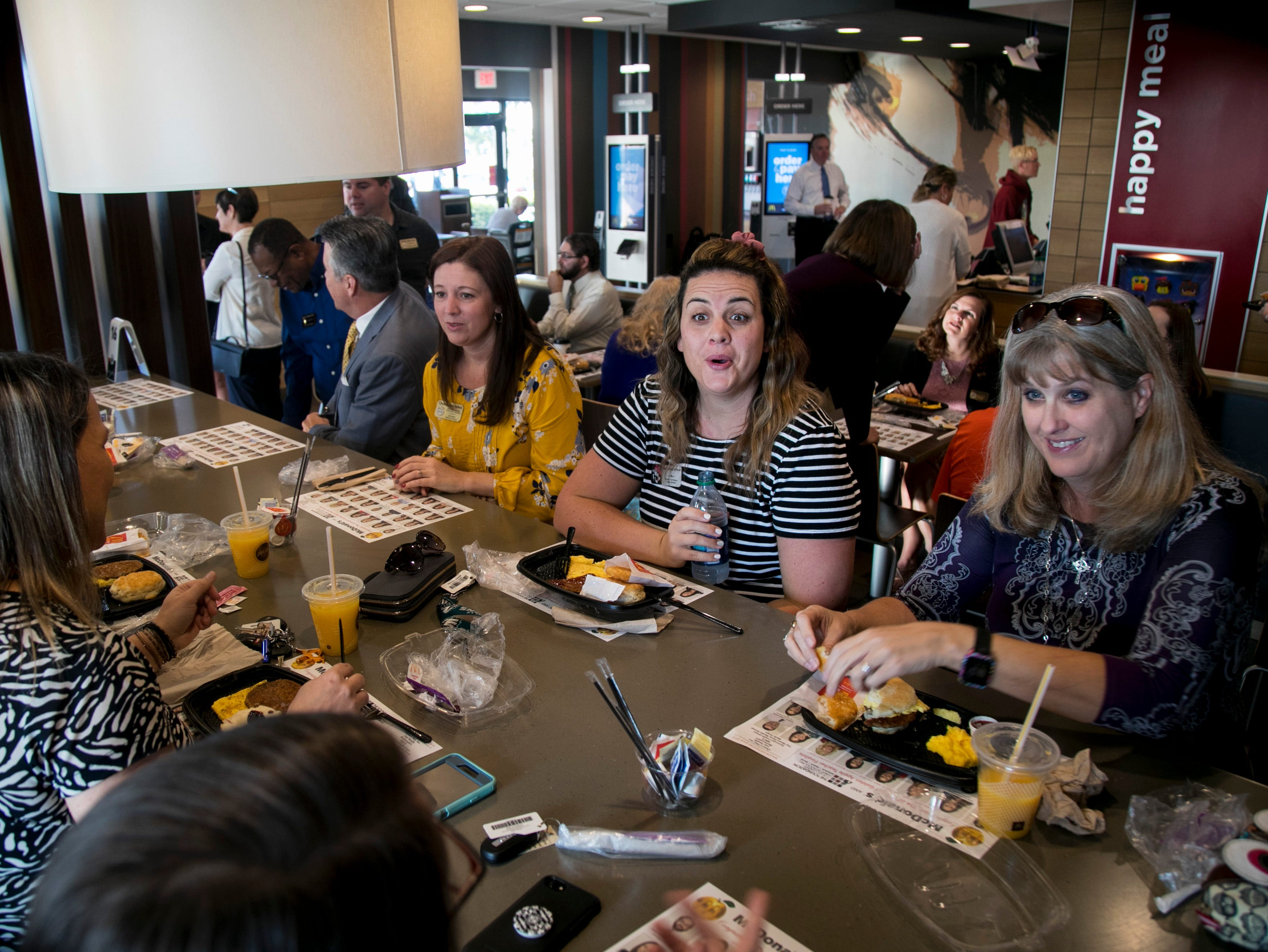 North Fort Myers High School teacher Kaleigh Stewart, center, chats with other Golden Apple finalists at the annual breakfast honoring the finalists at McDonald's on Colonial Boulevard in Fort Myers on Friday, Feb. 15, 2019. The event, hosted by the Foundation for Lee County Public Schools and McDonald's, also featured the unveiling of tray liners featuring photos of the 30 Golden Apple finalists.
