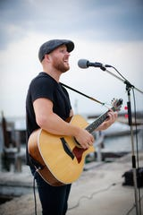 Matthew Burress performs on the dock outside the Shoreline Restaurant in Gills Rock. Now living in the Twin Cities, the Door County native returns for a Feb. 23 album release concert at Door Community Auditorium.