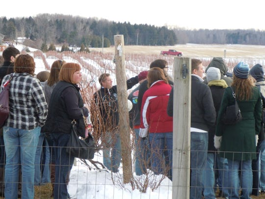 Parallel 44 Vineyard & Winery co-owner Steve Johnson, center, points out a feature of the vineyard while leading a tour during a past Frozen Tundra Wine Fest.