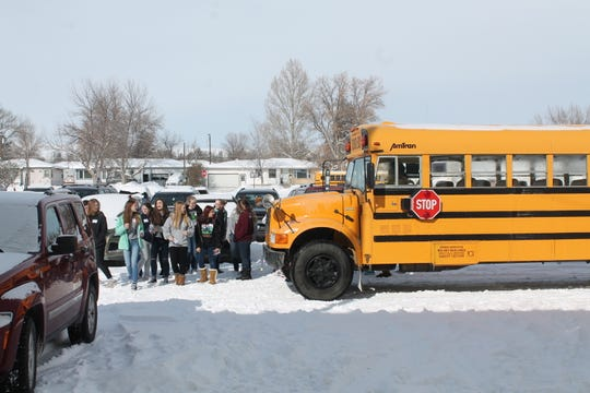 "East Middle School eight-grade girls getting off the bus to attend ""Girls in STEM"""