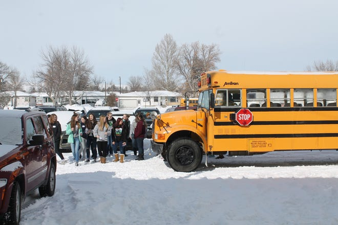 """East Middle School eight-grade girls getting off the bus to attend """"Girls in STEM"""""""