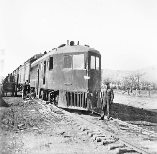 """One of the earliest successful self-propelled railcars relying on internal combustion was the McKeen car, shown here on the Montana, Wyoming & Southern Railroad near Bearcreek in 1920. Inventor William McKeen based his design on the torpedo boat. The MWS Railroad was a short-line coal carrier southwest of Billings. Locals called the """"submarine"""" or """"galloping goose."""" It could pull a few cars."""