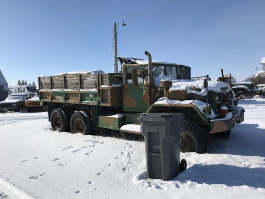 Danny Campanian, owner of the Glocca Morra Inn, owns about 35 six-by-six Army trucks in Sweet Grass, just this side of the Canadian border north of Shelby.