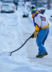 Ray Wardinsky shovels his sidewalk in Great Falls Friday. As of Sunday, 21.1 inches of snow has fallen in the city. Glasgow has that beat with its 24.4 inches, an all-time record.