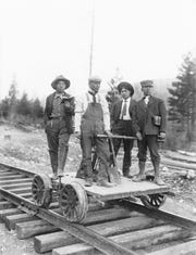 Japanese workers are photographed on a handcar used Milwaukee Railroad near Butte at time of construction of the line, circa 1905.