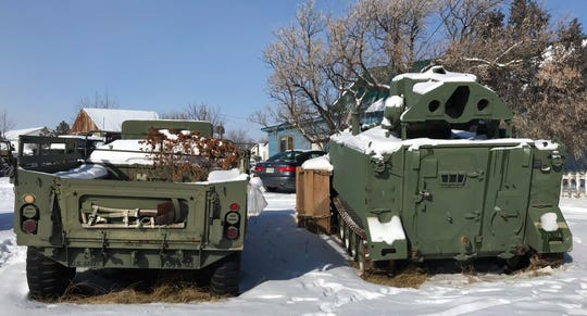 Danny Campanian, owner of the Glocca Morra Inn in Sweet Grass, has a collection of military vehicles.
