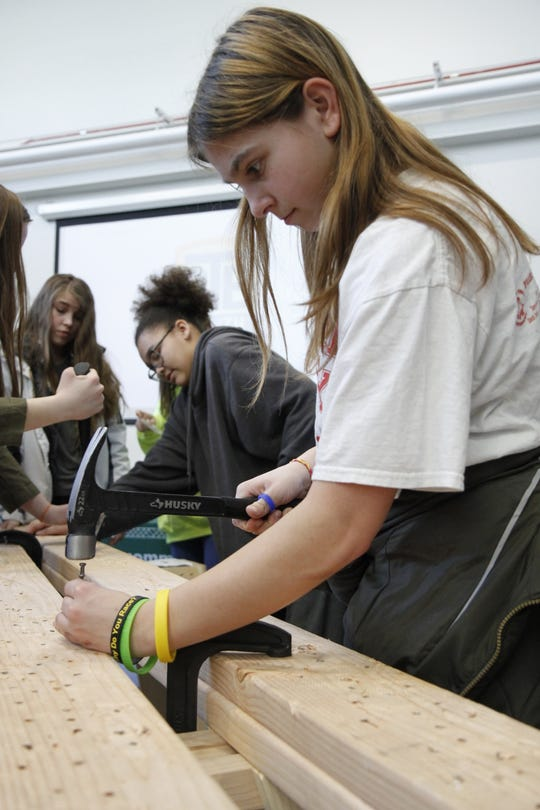 "The students were able to get hands-on experience at many of the booths at ""Girls in STEM."""