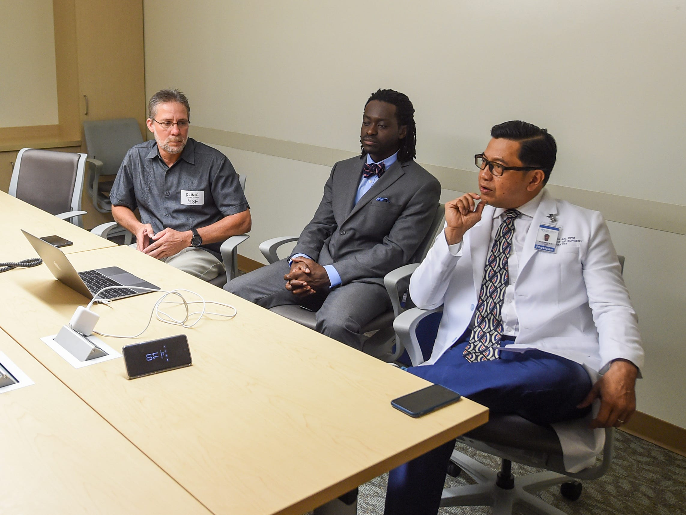 Dr. Noel Silan, right, with Dr. Kwasi Nyame, center, and Cano Collazo-Cruz, discusses the procedure that removed a tumor from the right leg of Collazo-Cruz, during an interview at the Guam Regional Medical City on Feb. 15, 2019.