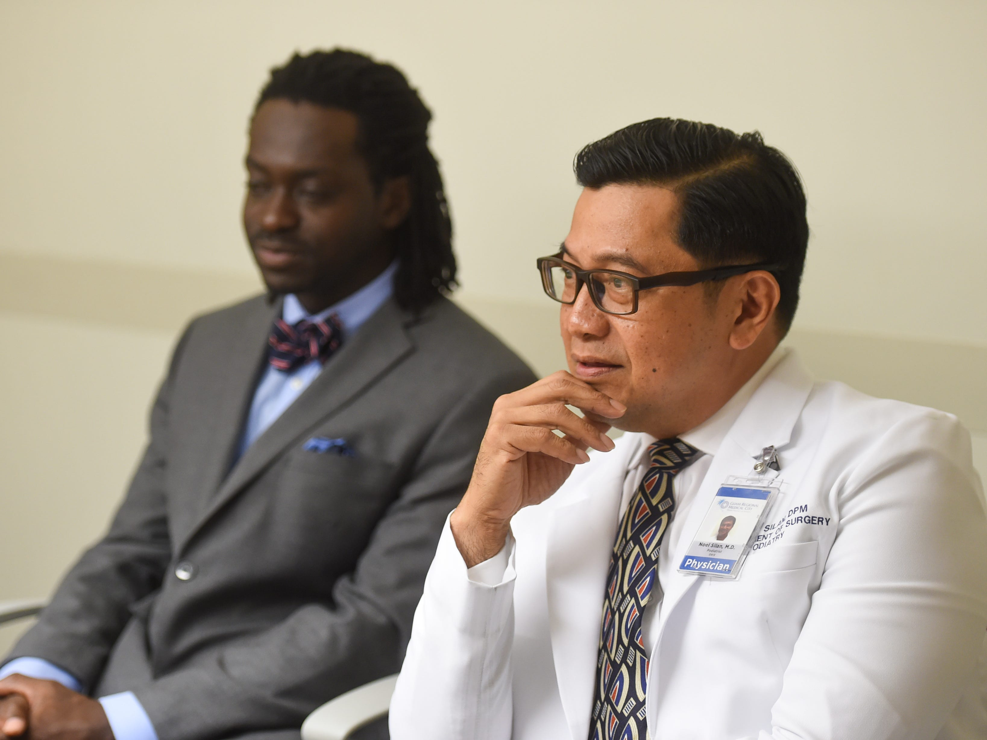Dr. Noel Silan, right, with Dr. Kwasi Nyame discusses his involvement in the surgery that removed a tumor from the right leg of Cano Collazo-Cruz, 56, during an interview at the Guam Regional Medical City on Feb. 15, 2019.