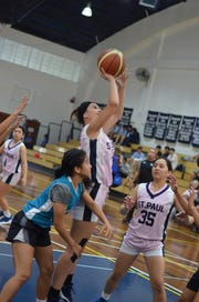 Saint Paul's Monica Giger puts up a shot against Consider the Lily during their game at the 2019 Asian Christian School's Conference Girls Basketball Tournament being held in Manila.