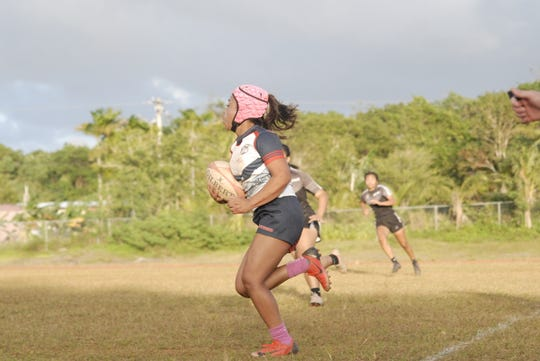Mara Tamayo uses her speed to get to the try line.