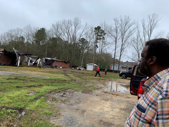 The Rev. Arthur Cohens, pastor of Greater New Life Apostolic Faith Church in Hattiesburg, looks at the building's remains on  Friday, Feb. 15, 2019. The church burned on Thursday, Feb. 14, 2019.
