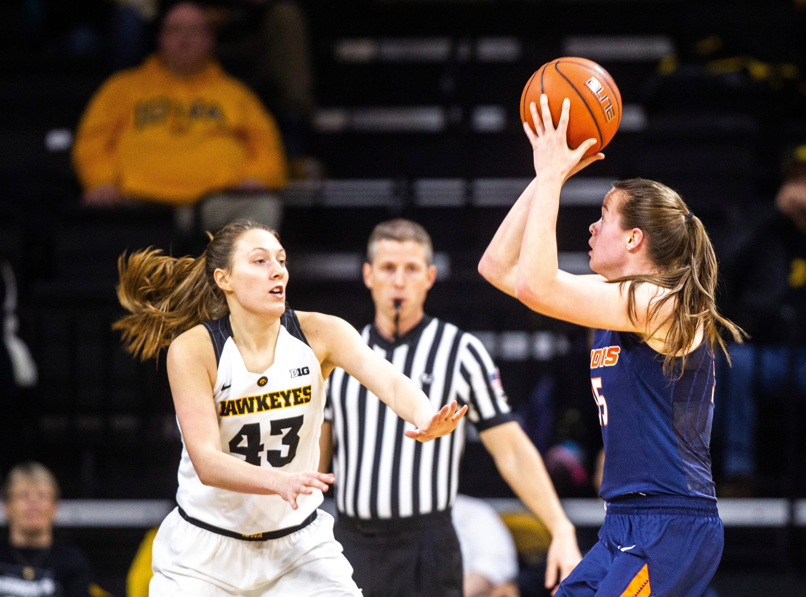 Iowa forward Amanda Ollinger (43) defends Illinois forward Alex Wittinger during a NCAA Big Ten Conference women's basketball game on Thursday, Feb. 14, 2019 at Carver-Hawkeye Arena in Iowa City, Iowa.