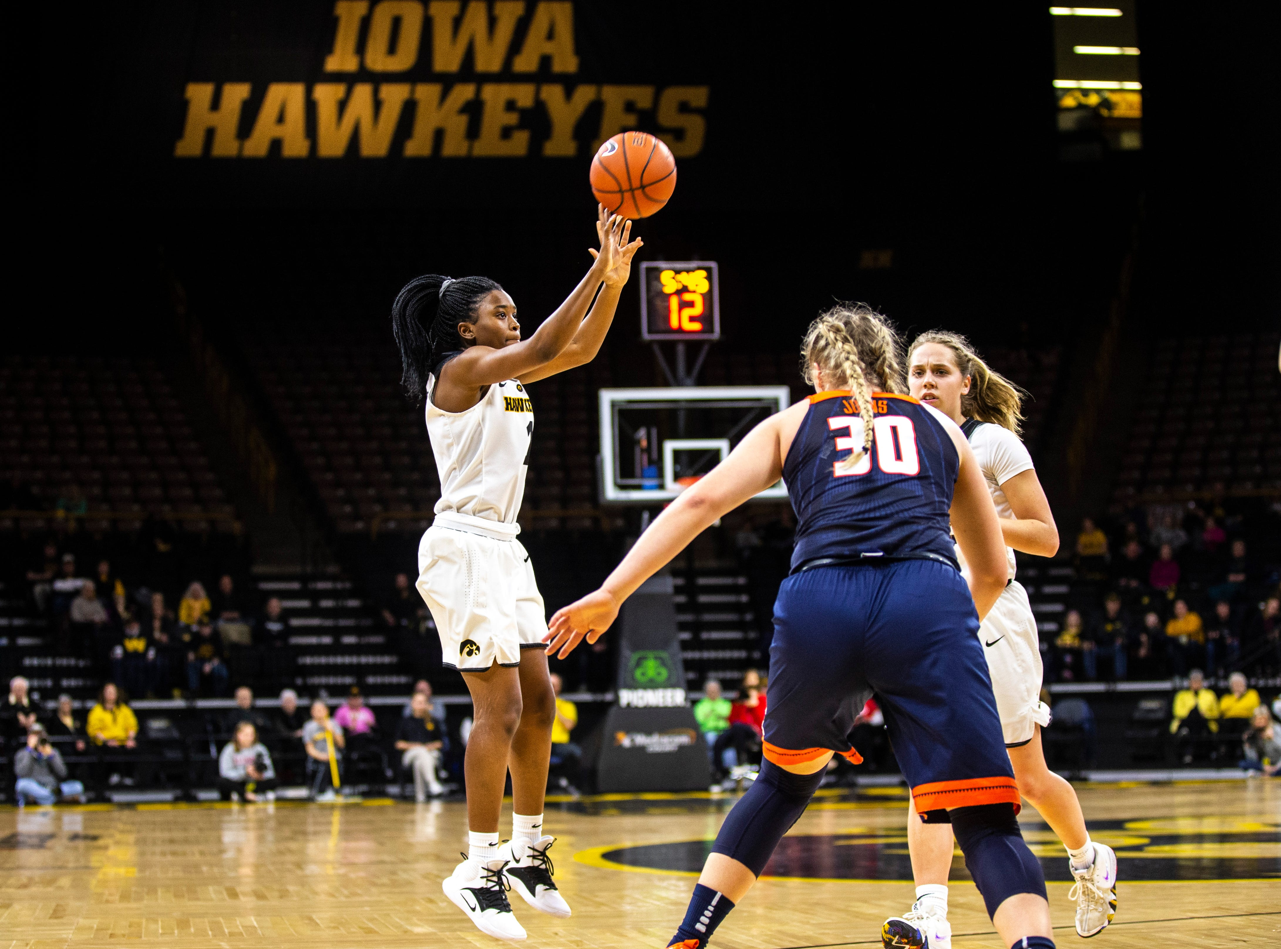 Iowa guard Tomi Taiwo (1) attempts a 3-point basket during a NCAA Big Ten Conference women's basketball game on Thursday, Feb. 14, 2019 at Carver-Hawkeye Arena in Iowa City, Iowa.