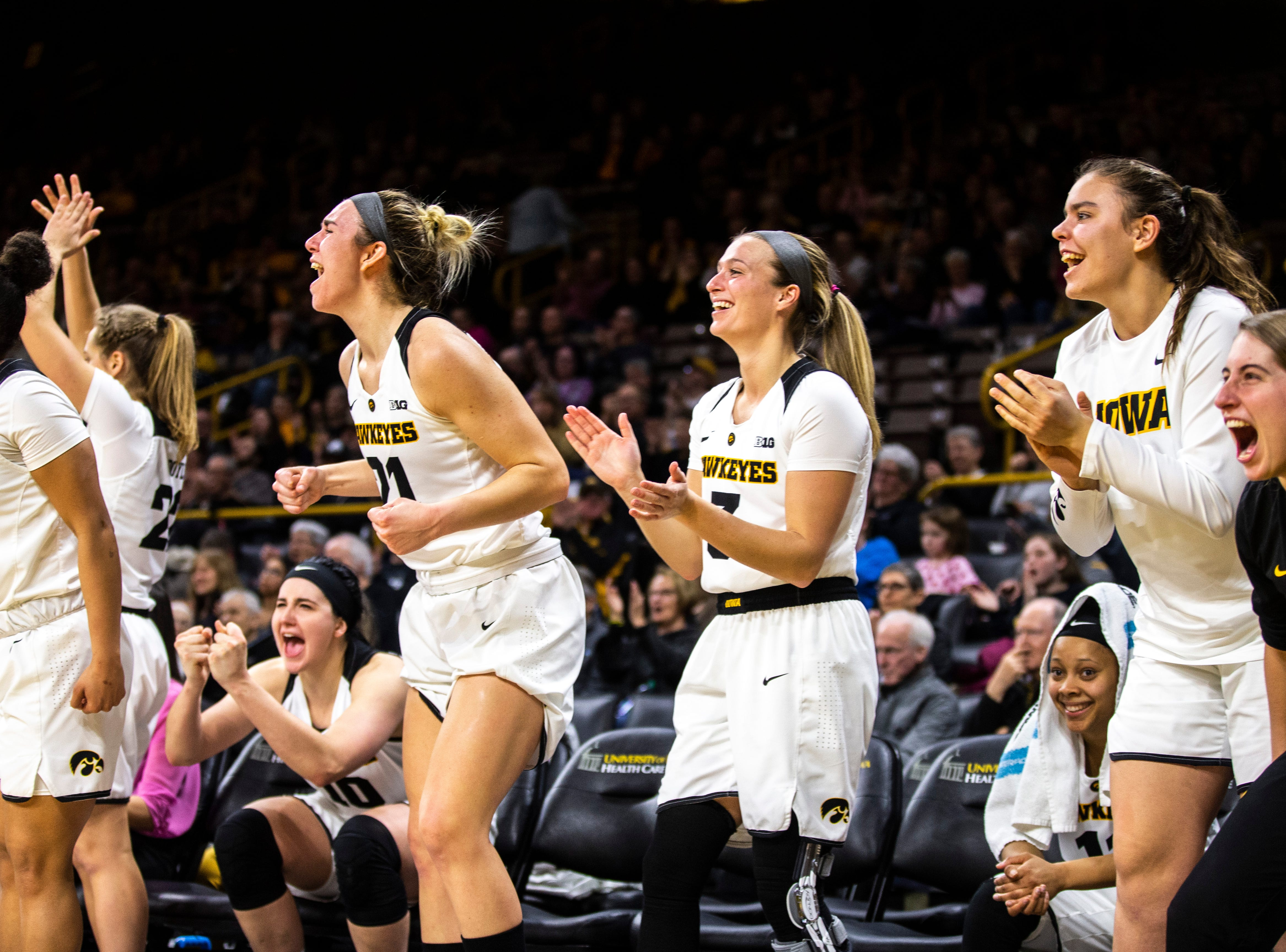 Iowa Hawkeyes bench celebrates during a NCAA Big Ten Conference women's basketball game on Thursday, Feb. 14, 2019 at Carver-Hawkeye Arena in Iowa City, Iowa.