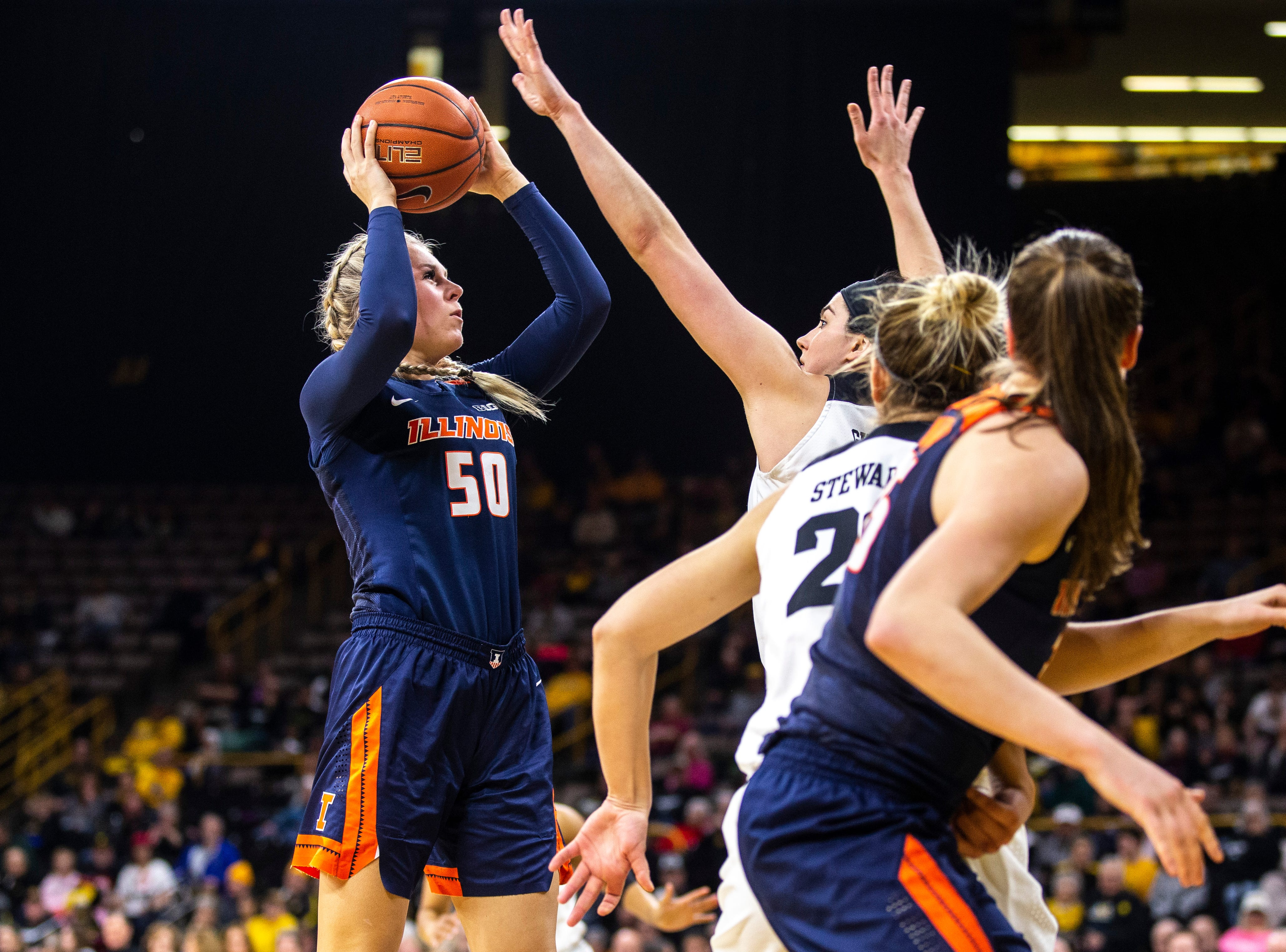 Illinois forward Ali Andrews (50) shoots while Iowa center Megan Gustafson (10) defends during a NCAA Big Ten Conference women's basketball game on Thursday, Feb. 14, 2019 at Carver-Hawkeye Arena in Iowa City, Iowa.