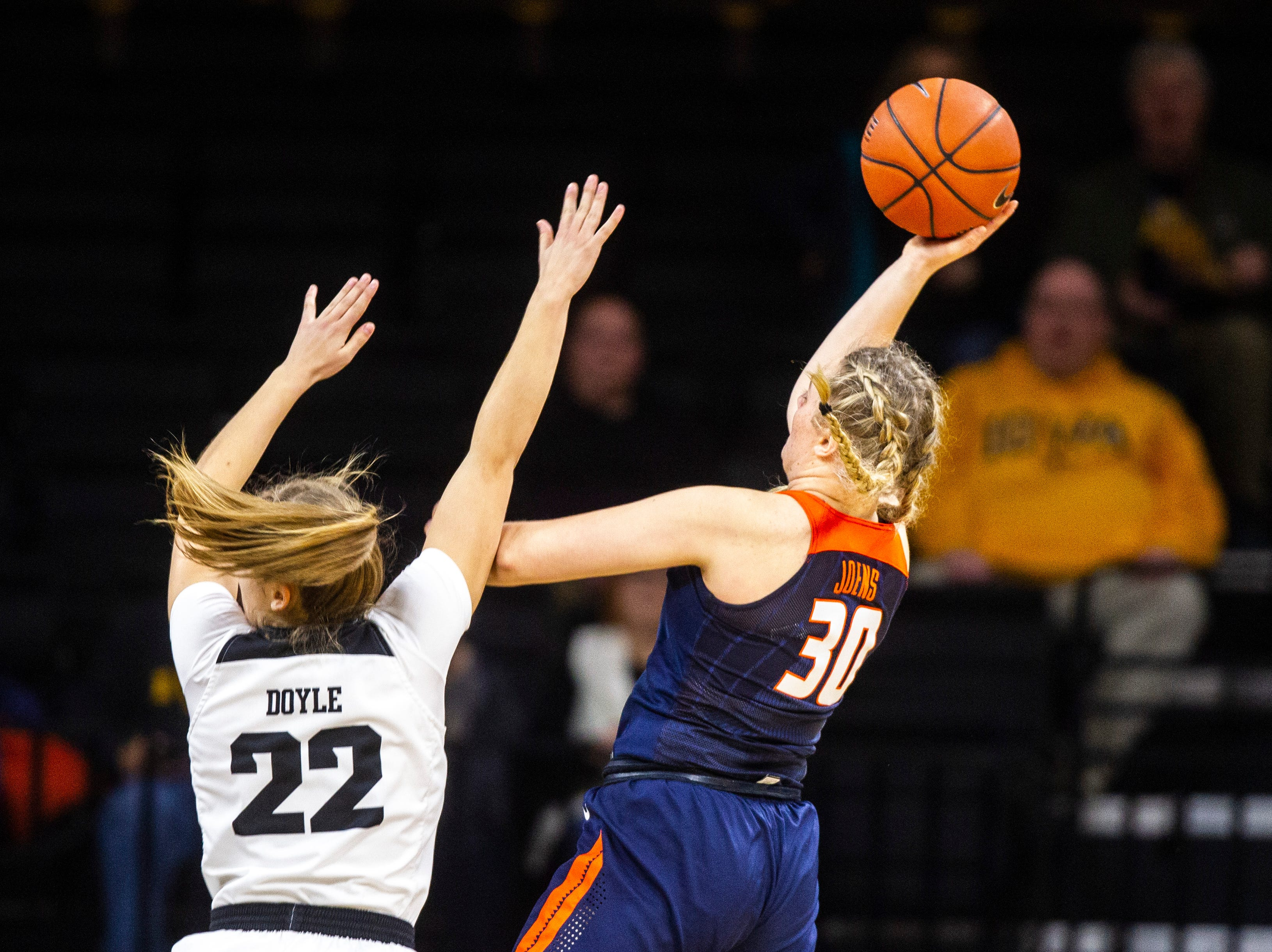 Illinois guard Courtney Joens (30) attempts a basket while Iowa guard Kathleen Doyle (22) defends during a NCAA Big Ten Conference women's basketball game on Thursday, Feb. 14, 2019 at Carver-Hawkeye Arena in Iowa City, Iowa.