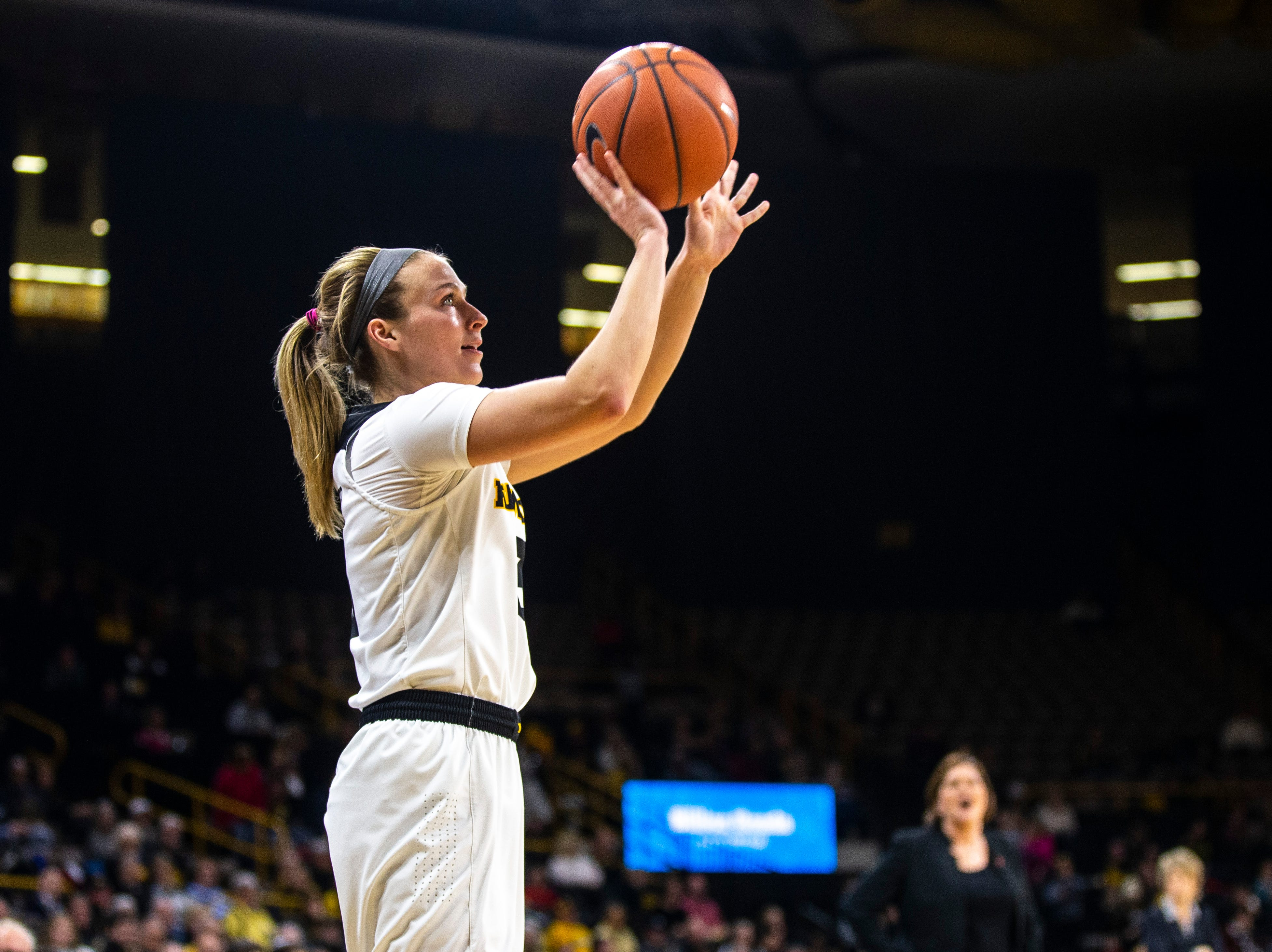 Iowa guard Makenzie Meyer (3) shoots a 3-point basket during a NCAA Big Ten Conference women's basketball game on Thursday, Feb. 14, 2019 at Carver-Hawkeye Arena in Iowa City, Iowa.