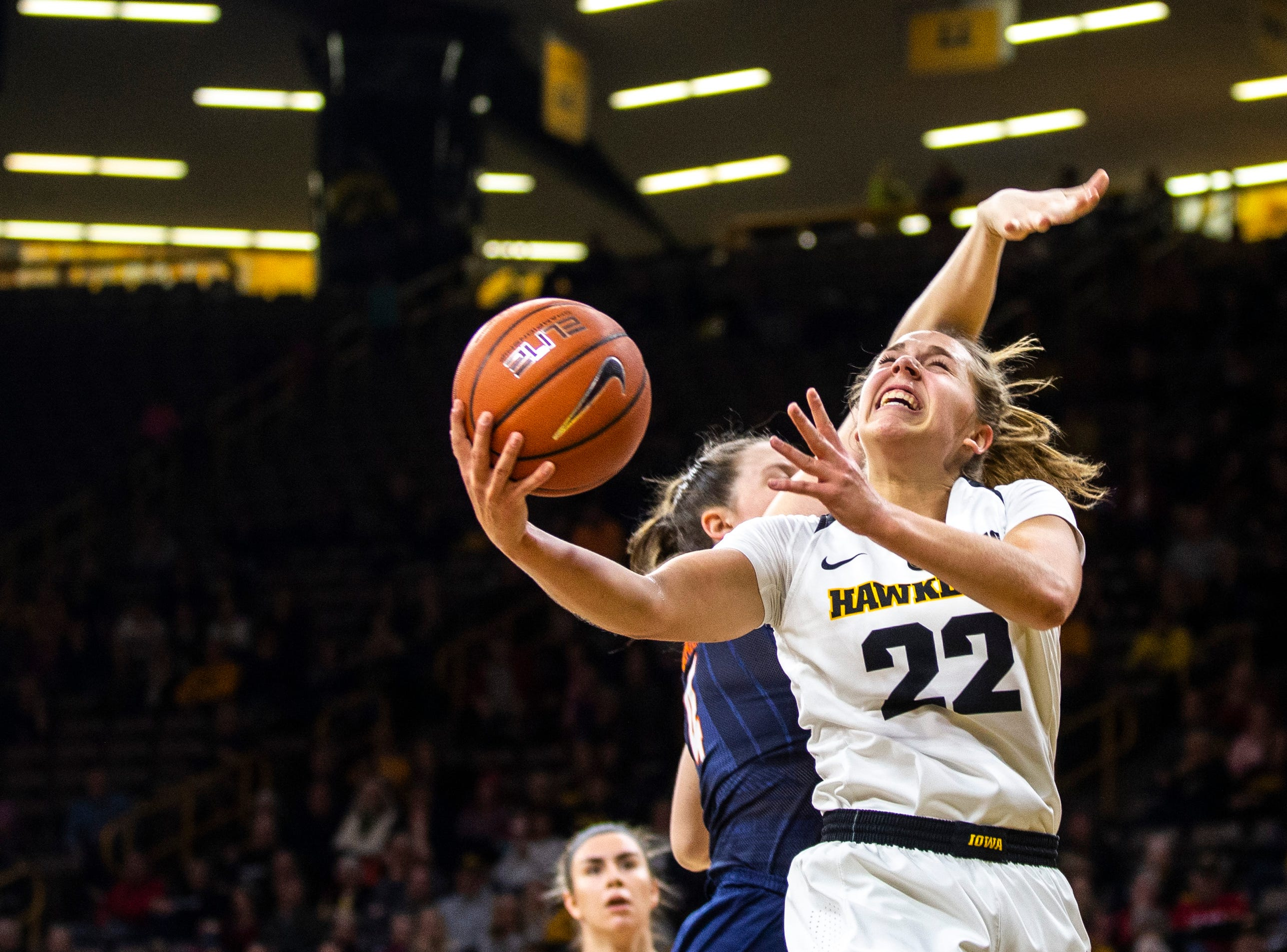Iowa guard Kathleen Doyle (22) attempts a basket during a NCAA Big Ten Conference women's basketball game on Thursday, Feb. 14, 2019 at Carver-Hawkeye Arena in Iowa City, Iowa.