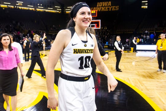 Iowa center Megan Gustafson (10) smiles after a NCAA Big Ten Conference women's basketball game against Illinois on Thursday, Feb. 14, 2019 at Carver-Hawkeye Arena in Iowa City, Iowa.