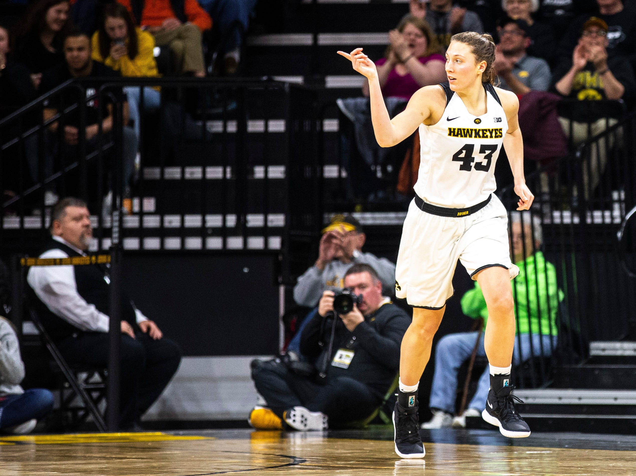Iowa forward Amanda Ollinger (43) celebrates after making a 3-point basket during a NCAA Big Ten Conference women's basketball game on Thursday, Feb. 14, 2019 at Carver-Hawkeye Arena in Iowa City, Iowa.