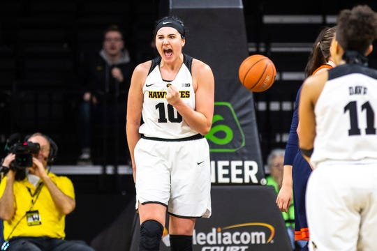 Iowa center Megan Gustafson (10) reacts after drawing a foul at the end of the third during a NCAA Big Ten Conference women's basketball game on Thursday, Feb. 14, 2019 at Carver-Hawkeye Arena in Iowa City, Iowa.