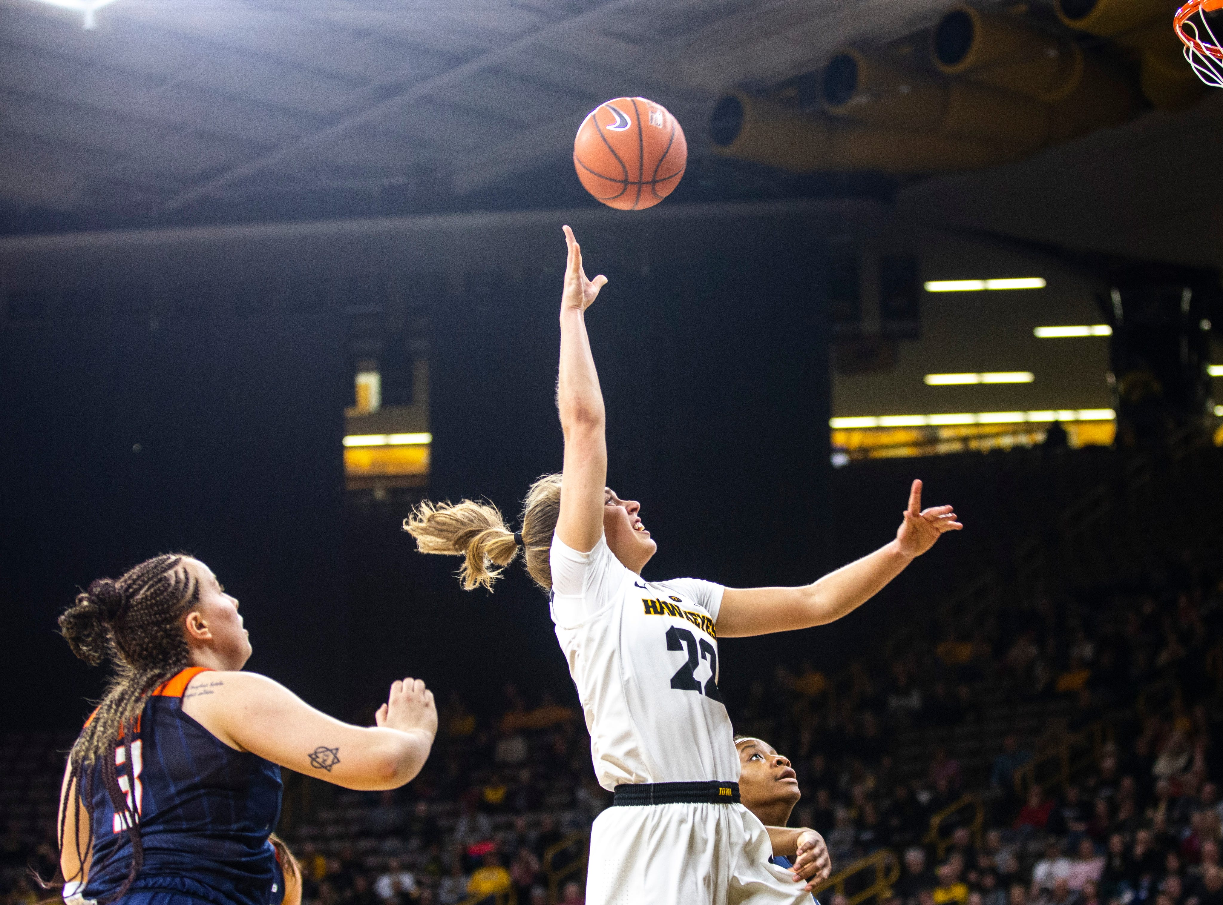 Iowa guard Kathleen Doyle (22) attempts a basket while Illinois guard Arieal Scott (3) defends during a NCAA Big Ten Conference women's basketball game on Thursday, Feb. 14, 2019 at Carver-Hawkeye Arena in Iowa City, Iowa.