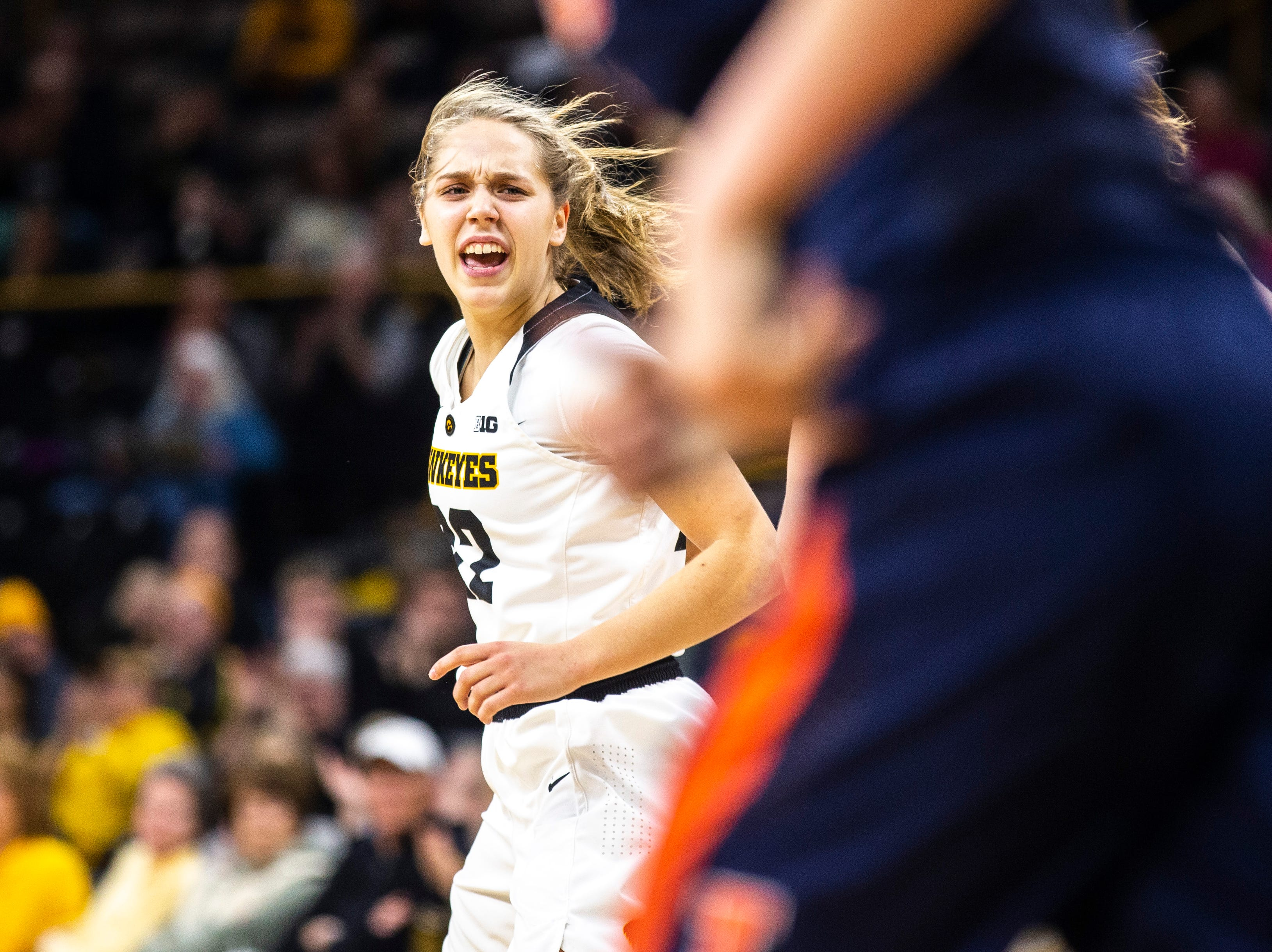 Iowa guard Kathleen Doyle (22) reacts after making a layup during a NCAA Big Ten Conference women's basketball game on Thursday, Feb. 14, 2019 at Carver-Hawkeye Arena in Iowa City, Iowa.