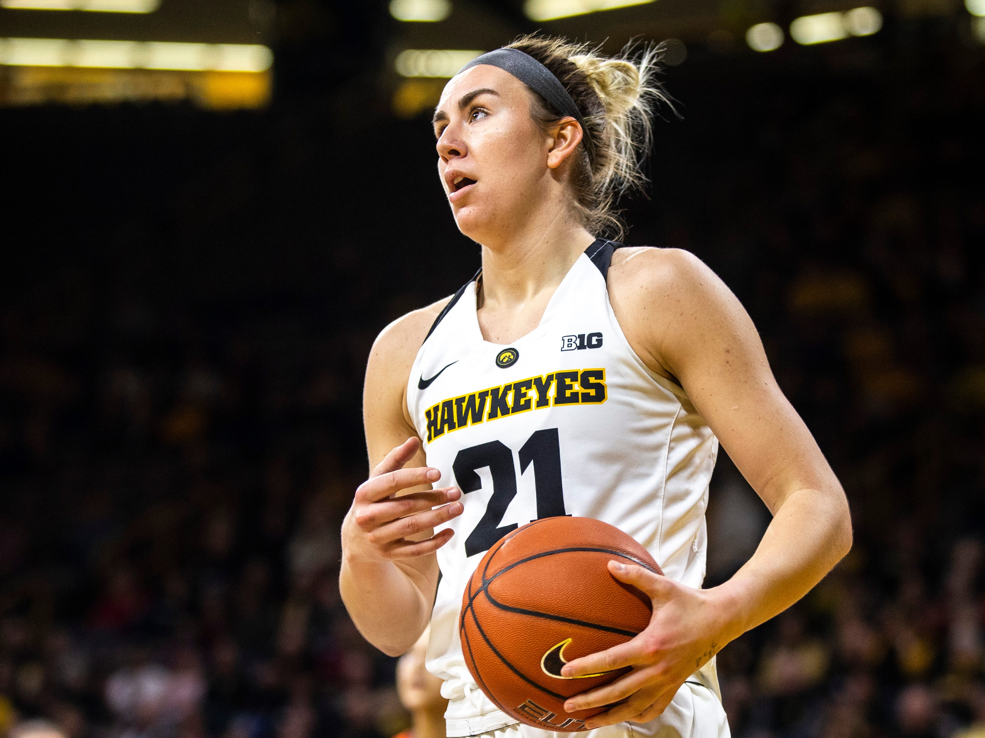 Iowa forward Hannah Stewart (21) reacts after getting fouled during a NCAA Big Ten Conference women's basketball game on Thursday, Feb. 14, 2019 at Carver-Hawkeye Arena in Iowa City, Iowa.