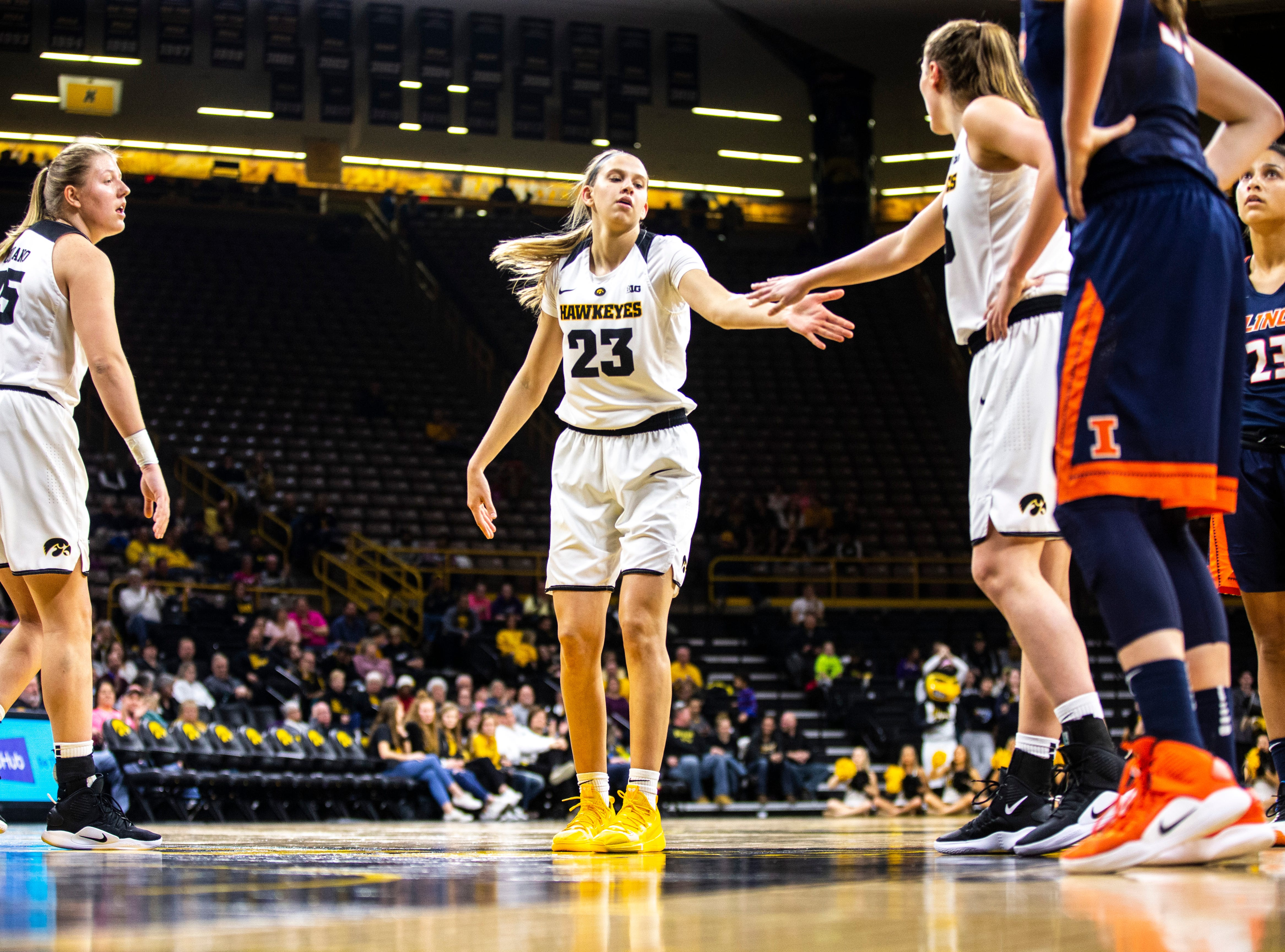 Iowa forward Logan Cook (23) gets a high five while shooting free throws during a NCAA Big Ten Conference women's basketball game on Thursday, Feb. 14, 2019 at Carver-Hawkeye Arena in Iowa City, Iowa.