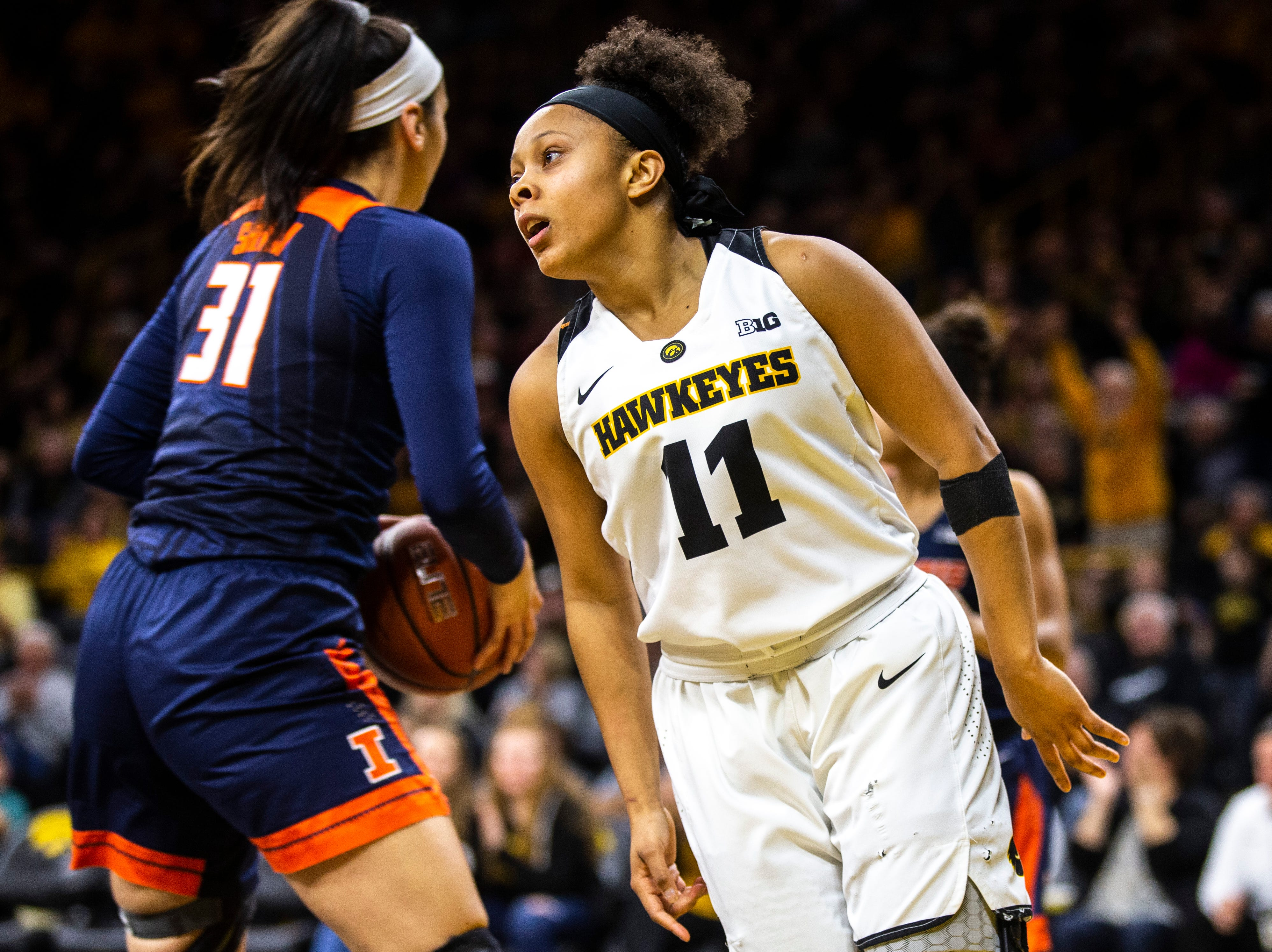 Iowa guard Tania Davis (11) reacts after making a layup during a NCAA Big Ten Conference women's basketball game on Thursday, Feb. 14, 2019 at Carver-Hawkeye Arena in Iowa City, Iowa.