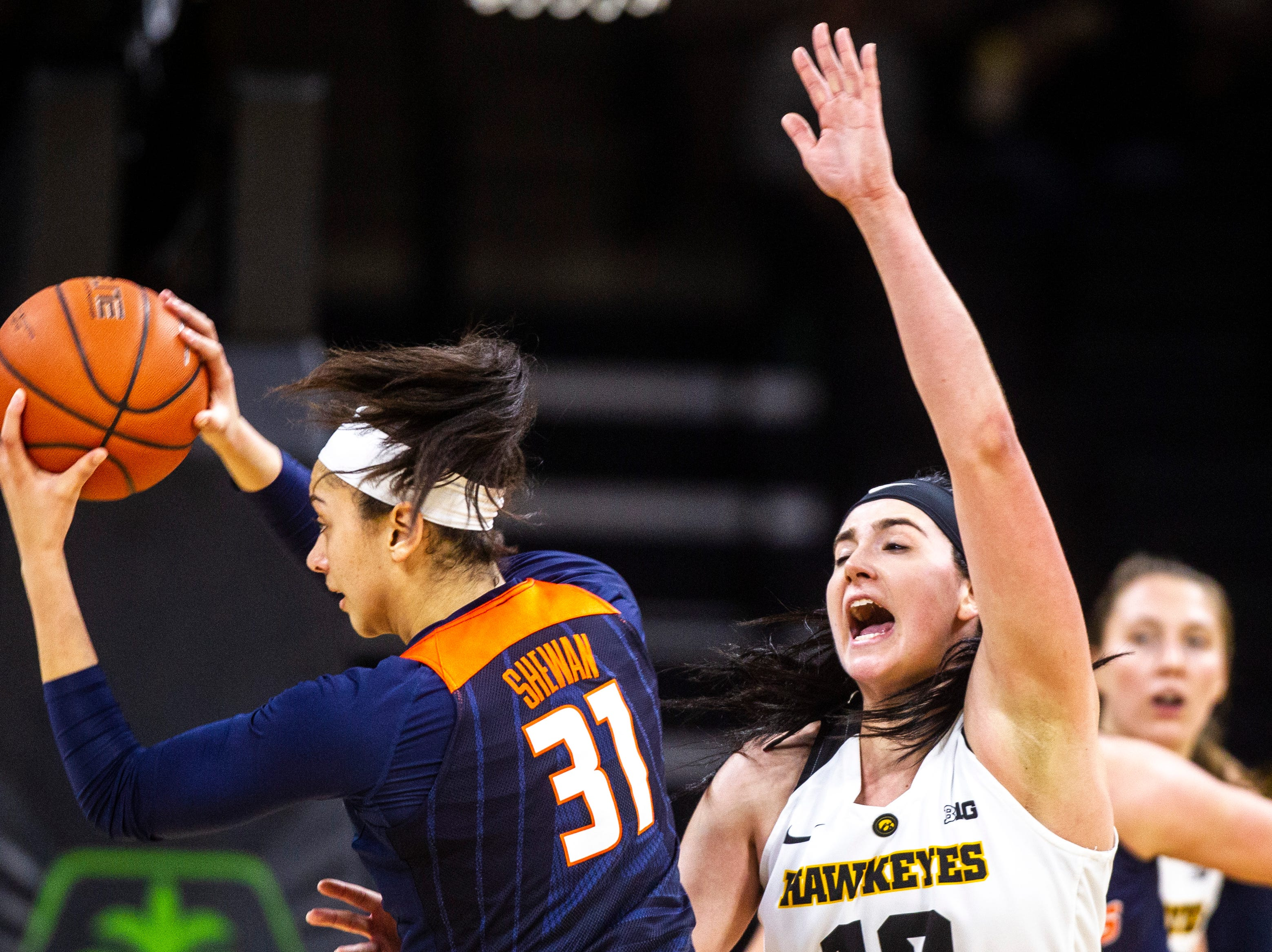 Illinois forward Sarah Shewan (31) drives to the basket while Iowa center Megan Gustafson, right, defends during a NCAA Big Ten Conference women's basketball game on Thursday, Feb. 14, 2019 at Carver-Hawkeye Arena in Iowa City, Iowa.