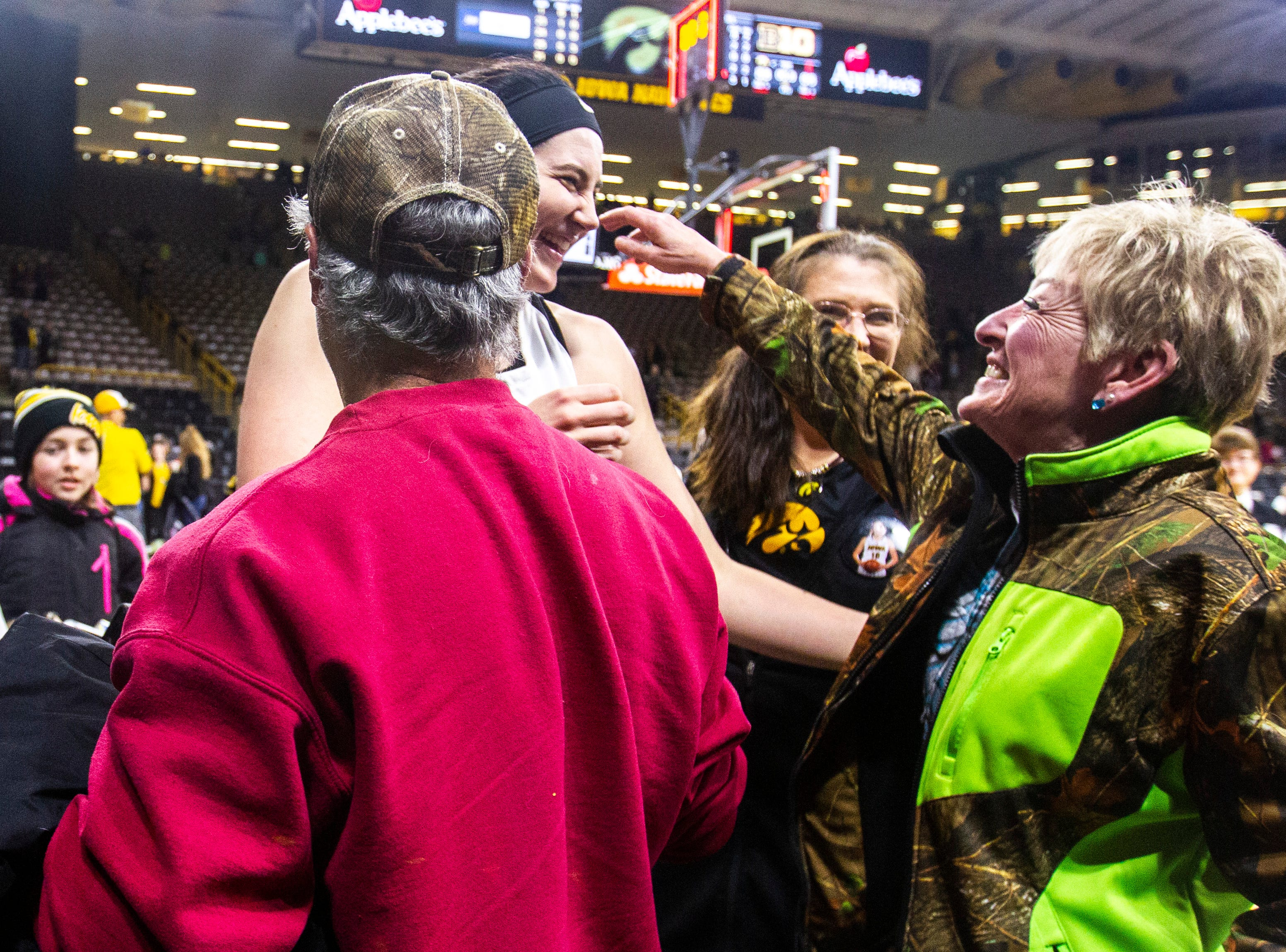 Iowa center Megan Gustafson (10) gets a hug from family members after a NCAA Big Ten Conference women's basketball game on Thursday, Feb. 14, 2019 at Carver-Hawkeye Arena in Iowa City, Iowa.