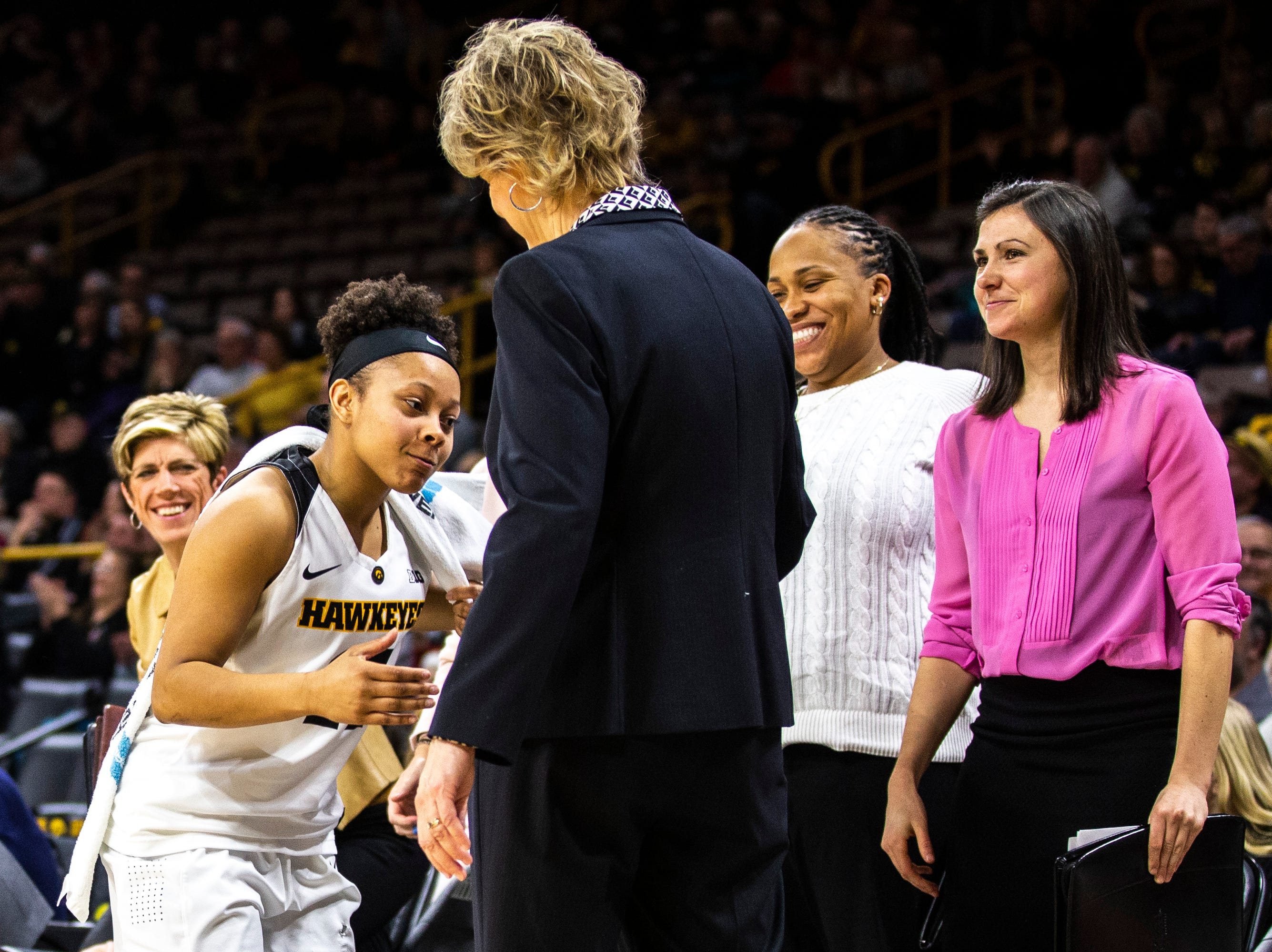Iowa guard Tania Davis (11) shakes hands with Iowa head coach Lisa Bluder during a NCAA Big Ten Conference women's basketball game on Thursday, Feb. 14, 2019 at Carver-Hawkeye Arena in Iowa City, Iowa.