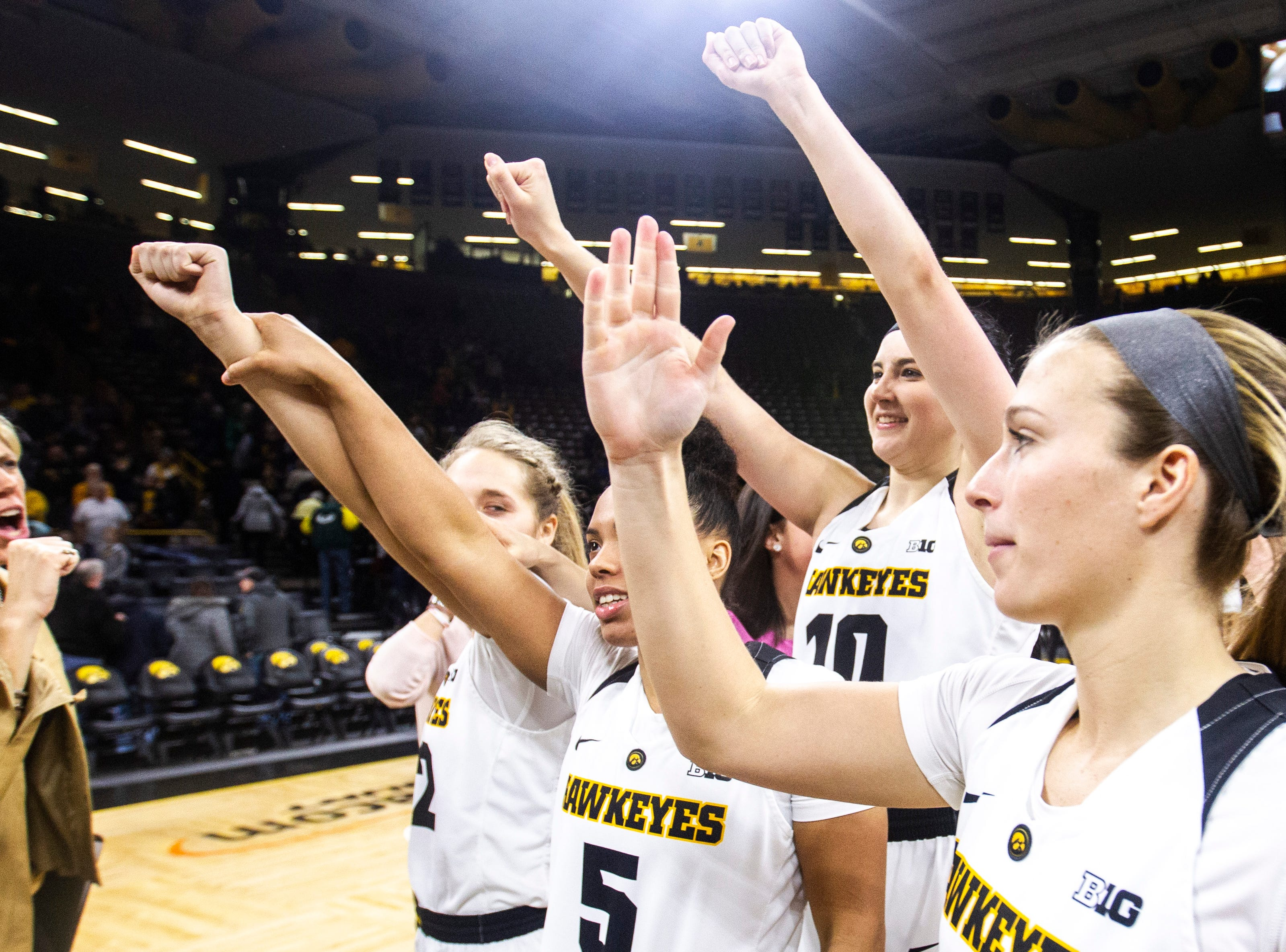 Iowa Hawkeyes celebrate after a NCAA Big Ten Conference women's basketball game against Illinois on Thursday, Feb. 14, 2019 at Carver-Hawkeye Arena in Iowa City, Iowa.