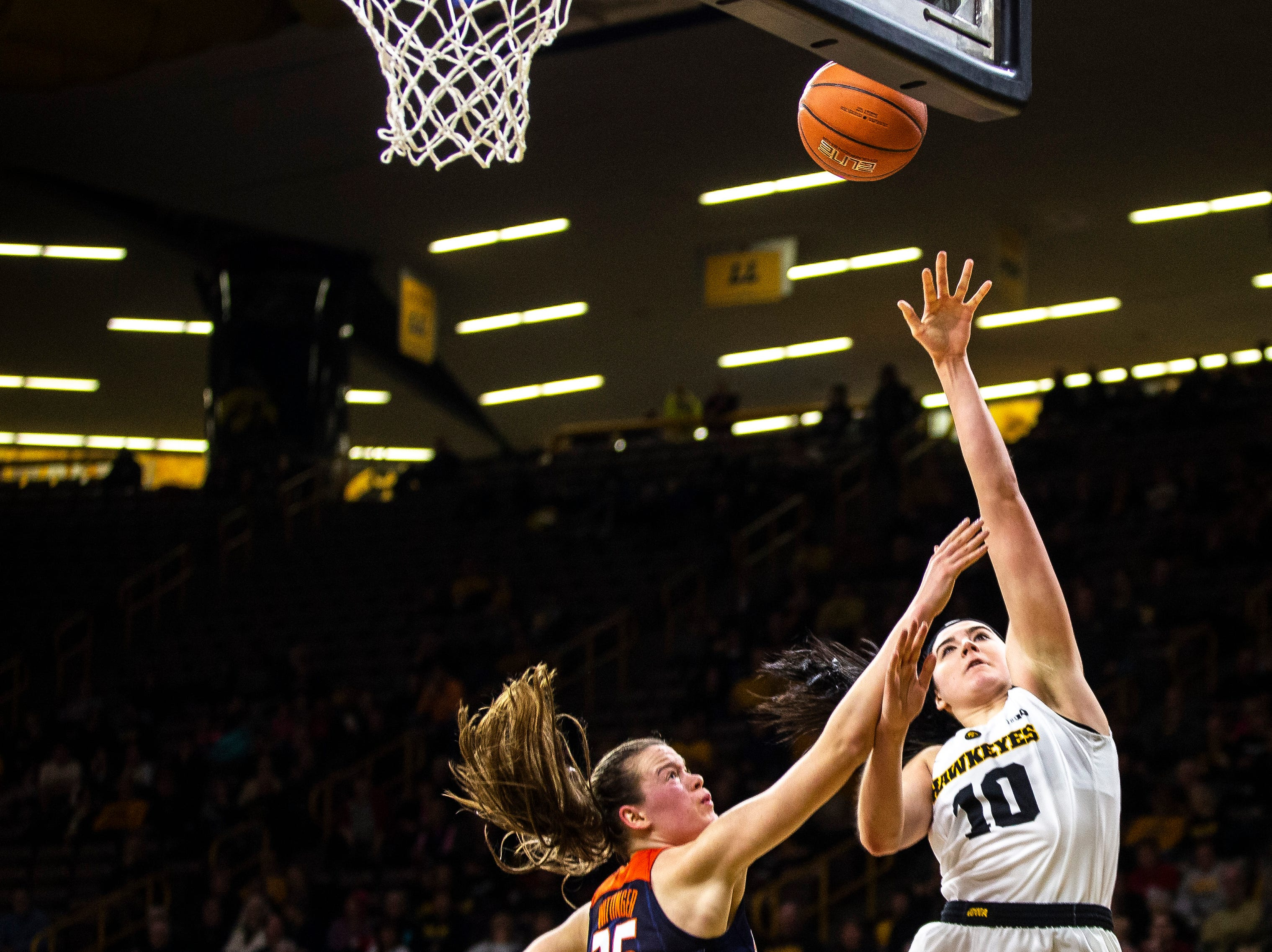 Iowa center Megan Gustafson (10) attempts a basket while Illinois forward Alex Wittinger defends during a NCAA Big Ten Conference women's basketball game on Thursday, Feb. 14, 2019 at Carver-Hawkeye Arena in Iowa City, Iowa.